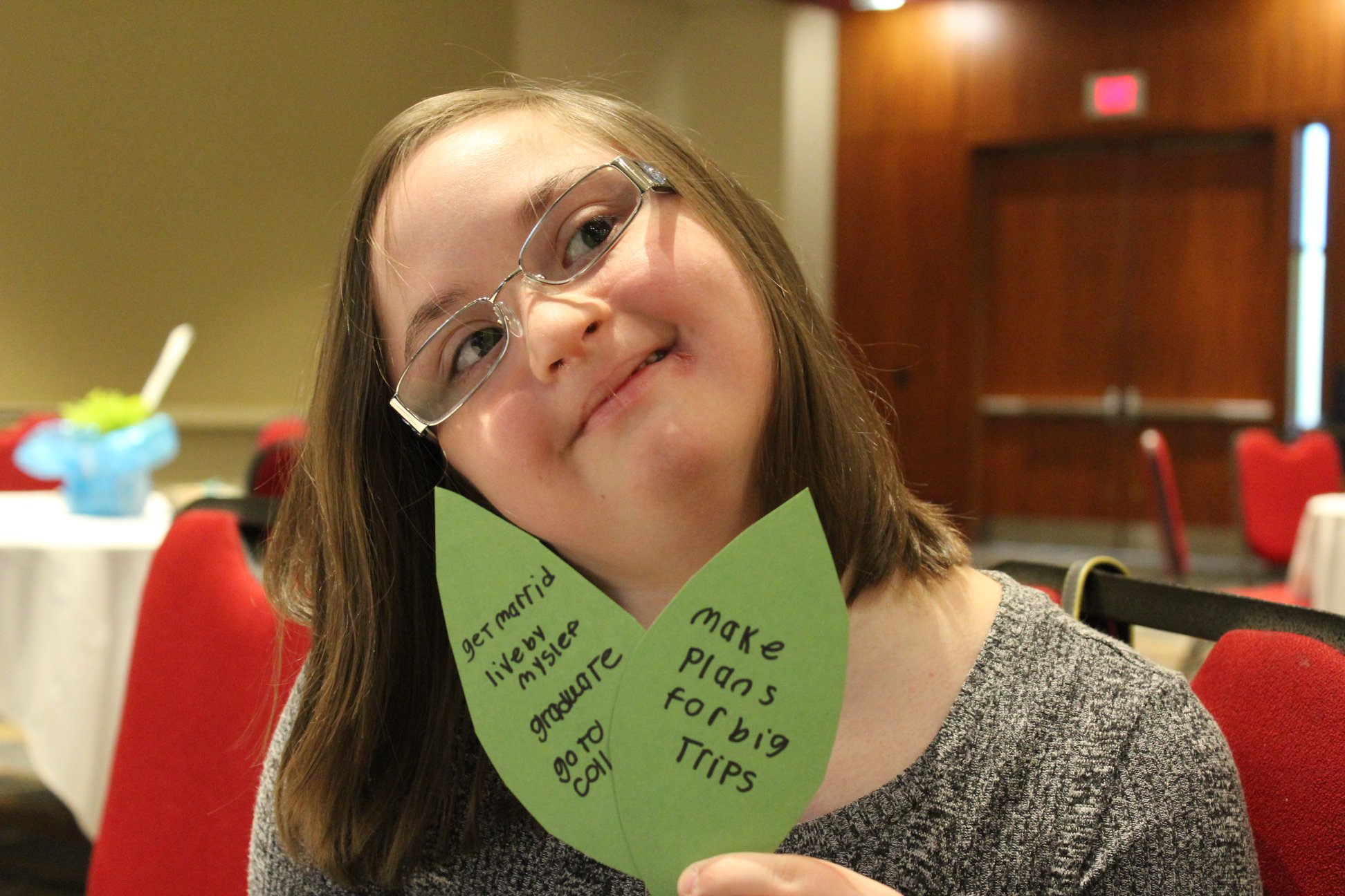 youth services - girl holding plans for future