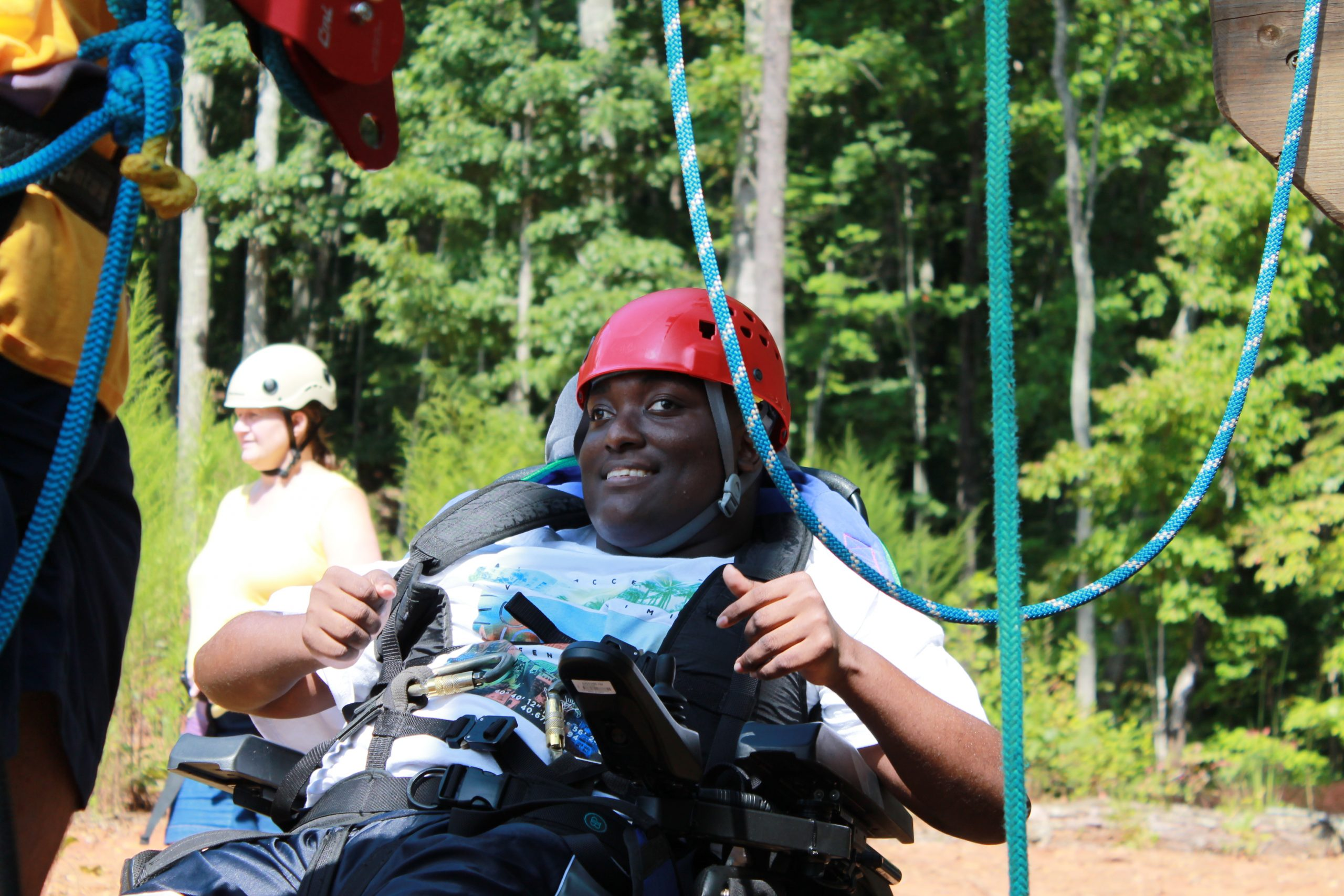 girl on outdoor course in wheelchair