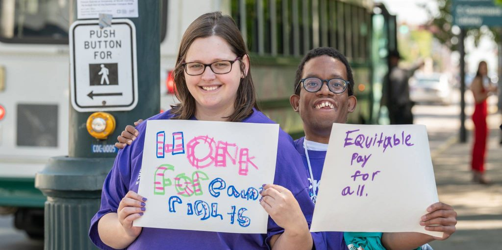boy and girl advocating for equal pay